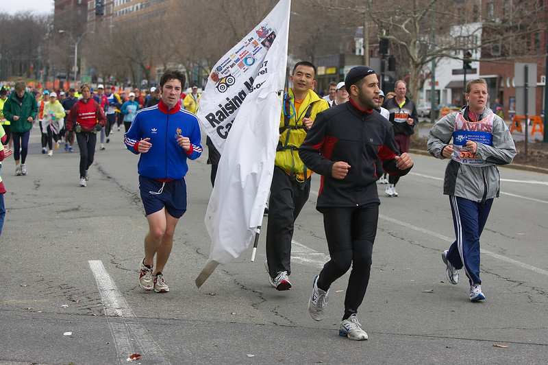 """Liyan Guo, center, runs with his 8x4' flag to raise money for cancer.  See the Boston Herald story:   <a href=""""http://business.bostonherald.com/businessNews/view.bg?articleid=194826"""">http://business.bostonherald.com/businessNews/view.bg?articleid=194826</a>"""