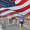 US Flag and Marathon Runners