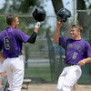 """Dylan Platt (5) of Boulder celebrates his home run with Nate Bukowski of Boulder  against Fossil Ridge on Friday in Legion Baseball. Boulder won 17-10.<br /> For  more photos of the game, go to  <a href=""""http://www.dailycamera.com"""">http://www.dailycamera.com</a>.<br /> Cliff Grassmick  / August 3, 2012"""