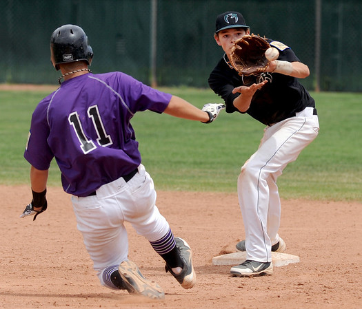 "Ray Feigal of Boulder tries to get to second before Codi Heuer of Fossil Ridge, can make the out during Legion play on Friday.<br /> For  more photos of the game, go to  <a href=""http://www.dailycamera.com"">http://www.dailycamera.com</a>.<br /> Cliff Grassmick  / August 3, 2012"