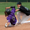 """Nate Bukowski of Boulder tries to get to second before Codi Heuer of Fossil Ridge, can make the out during Legion play on Friday.<br /> For  more photos of the game, go to  <a href=""""http://www.dailycamera.com"""">http://www.dailycamera.com</a>.<br /> Cliff Grassmick  / August 3, 2012"""