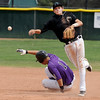 """Ray Feigal of Boulder is out at  second as Codi Heuer of Fossil Ridge, tries for the double play during Legion play on Friday.<br /> For  more photos of the game, go to  <a href=""""http://www.dailycamera.com"""">http://www.dailycamera.com</a>.<br /> Cliff Grassmick  / August 3, 2012"""