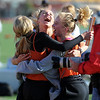 "Makenzie Eberthart, Shelby Brow, Madeline Anderson and Marissa Atkins, of Erie High School, celebrate breaking the school record in the 3200 meter relay.<br /> For a  photo gallery of the track meet, go to  <a href=""http://www.dailycamera.com"">http://www.dailycamera.com</a>.<br /> Cliff Grassmick/ April 16, 2011"