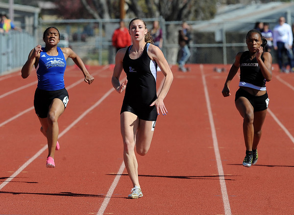 "Rachel Hinker, center, of Lyons High School wins the 100 meter dash on Saturday. Khadijah Sayyid of Peak to Peak, is on the left, and Deaydrah Williams of Boulder is on the right.<br /> For a  photo gallery of the track meet, go to  <a href=""http://www.dailycamera.com"">http://www.dailycamera.com</a>.<br /> Cliff Grassmick/ April 16, 2011"