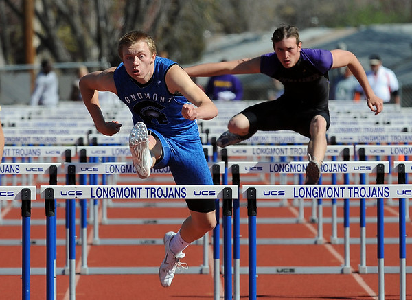 """Josh Cogdill,  of Longmont High School, wins the 110 meter hurdles on Saturday.<br /> For a  photo gallery of the track meet, go to  <a href=""""http://www.dailycamera.com"""">http://www.dailycamera.com</a>.<br /> Cliff Grassmick/ April 16, 2011"""