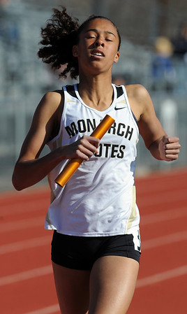 "Claire Green of Monarch helps her team win the 3200 meter relay on Saturday.<br /> For a  photo gallery of the track meet, go to  <a href=""http://www.dailycamera.com"">http://www.dailycamera.com</a>.<br /> Cliff Grassmick/ April 16, 2011"
