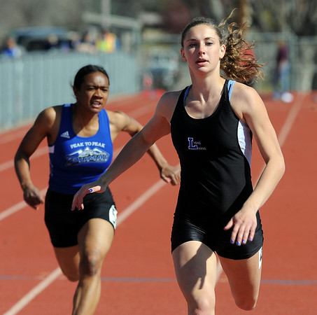 "Rachel Hinker, right, of Lyons High School wins the 100 meter dash on Saturday. Khadijah Sayyid of Peak to Peak, is on the left.<br /> For a  photo gallery of the track meet, go to  <a href=""http://www.dailycamera.com"">http://www.dailycamera.com</a>.<br /> Cliff Grassmick/ April 16, 2011"