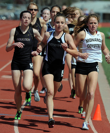 "Erin McLaughlin, left,  of Boulder High School, wins the girls 1600 meters on Saturday.Elise Crany of Niwot, center, was second.<br /> For a  photo gallery of the track meet, go to  <a href=""http://www.dailycamera.com"">http://www.dailycamera.com</a>.<br /> Cliff Grassmick/ April 16, 2011"
