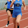 Samantha Kee of Longmont wins the 100 meters at the Boulder County Championships on Saturday in Broomfield.<br /> Cliff Grassmick / April 17, 2010