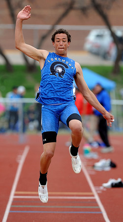 Tevan McIntire of Longmont competes in the long jump on Saturday at the Boulder County Championships.<br /> Cliff Grassmick / April 17, 2010