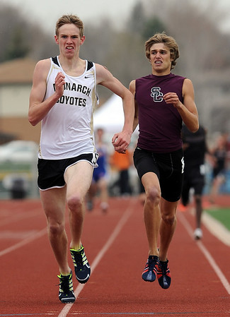 Kirk Webb, left, of Monarch, edged out Alex Paul of Silver Creek, to win the 1600 meters at the Boulder County Championships on Saturday. <br /> Cliff Grassmick / April 17, 2010