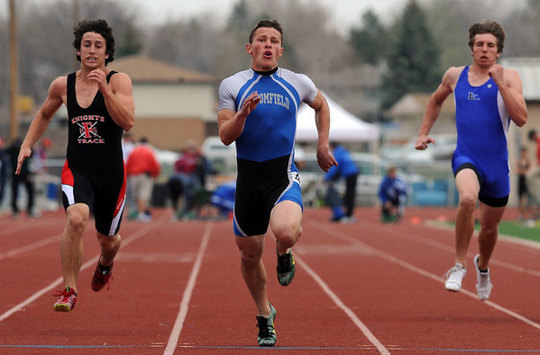 Trent Ireland, center, of Broomfield, wins the 100 meters at the Boulder County Championships on Saturday.<br /> Cliff Grassmick / April 17, 2010