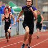 Rex Quartarone of Boulder High runs the anchor of the 4X200 meters on Saturday.<br /> Cliff Grassmick / April 17, 2010