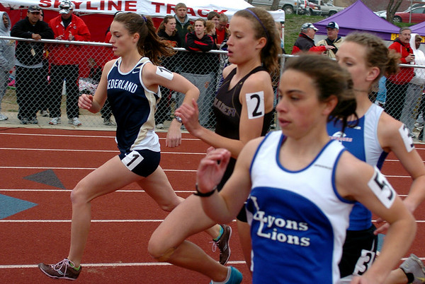 Kat Robinson, left,  of Nederland wins  the 1600 meters at the Boulder County Championships.<br /> Cliff Grassmick / April 17, 2010