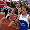 Kat Robinson, left,  of Nederland wins  the 1600 meters at the Boulder County Championships.<br /> Cliff Grassmick / April 17, 2010