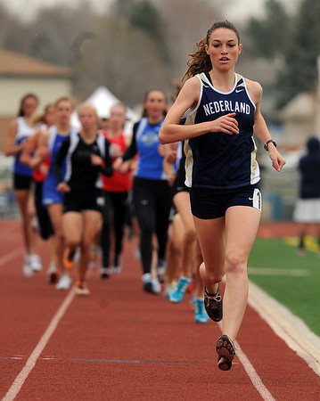Kat Robinson of Nederland wins  the 1600 meters at the Boulder County Championships.<br /> Cliff Grassmick / April 17, 2010