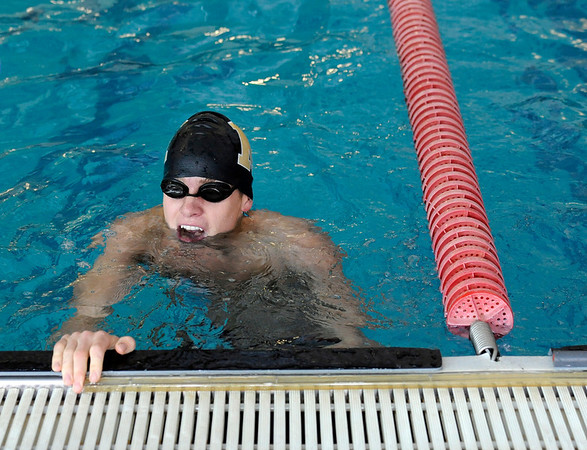 """Monarch High School's Willy VanDehy tries to catch his breath after winning the 50-Yard Freestyle race during a Boulder county swim meet on Saturday, April 16, at the South Boulder Recreation Center in Boulder.<br /> For more photos and video go to  <a href=""""http://www.dailycamera.com"""">http://www.dailycamera.com</a><br /> Jeremy Papasso/ Camera"""