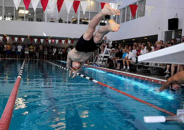 """Longmont High School's Tony Huff dives into the water at the start of the 200-yard Freestyle race during a Boulder county swim meet on Saturday, April 16, at the South Boulder Recreation Center in Boulder. <br /> For more photos and video go to  <a href=""""http://www.dailycamera.com"""">http://www.dailycamera.com</a><br /> Jeremy Papasso/ Camera"""
