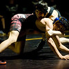 Boulder's Garth Goodrich (top) and Horizon's Max DiGiacomo wrestle during the match at Monarch High School in Louisville, Thursday, Jan. 28, 2010.  <br /> KASIA BROUSSALIAN