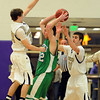 "Riley Grabau, left, and Ethan Baker, both of Boulder High, pressure Dylan Sisneros of Doherty.<br /> For more photos of the game, go to  <a href=""http://www.dailycamera.com"">http://www.dailycamera.com</a>.<br /> Cliff Grassmick/ February 26, 2011"