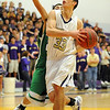 "Andre Rieder of Boulder High drives past Wil Romero of Doherty.<br /> For more photos of the game, go to  <a href=""http://www.dailycamera.com"">http://www.dailycamera.com</a>.<br /> Cliff Grassmick/ February 26, 2011"