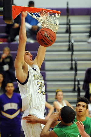 """Andre Rieder of Boulder High, dunks an alley-oop pass from Riley Grabau against Doherty.<br /> For more photos of the game, go to  <a href=""""http://www.dailycamera.com"""">http://www.dailycamera.com</a>.<br /> Cliff Grassmick/ February 26, 2011"""