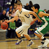 "Riley Grabau of Boulder High, on the fast break past  Wil Romero of Doherty.<br /> For more photos of the game, go to  <a href=""http://www.dailycamera.com"">http://www.dailycamera.com</a>.<br /> Cliff Grassmick/ February 26, 2011"