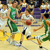 "Riley Grabau of Boulder High, on the fast break past Dylan Sisneros (32) and  Wil Romero, both  of Doherty.<br /> For more photos of the game, go to  <a href=""http://www.dailycamera.com"">http://www.dailycamera.com</a>.<br /> Cliff Grassmick/ February 26, 2011"