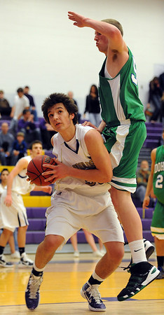"Loren Ban of Boulder High, pump fakes Jacob Lancaster of Doherty.<br /> For more photos of the game, go to  <a href=""http://www.dailycamera.com"">http://www.dailycamera.com</a>.<br /> Cliff Grassmick/ February 26, 2011"