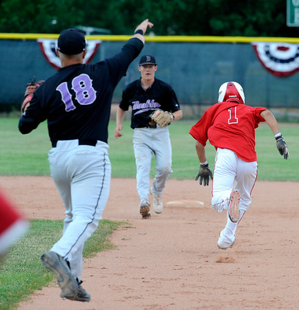 Boulder Eagles first baseman Danny Graves throws to Shortstop Colby Smith while Centaurus High School's Tristan Archuleta is caught in a run down. Archuleta made it safely to second base.<br /> Photo by Paul Aiken / The Camera / July 6, 2011