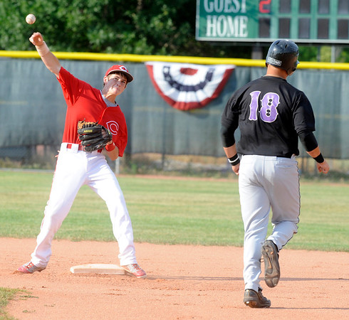 Centaurus High School's Second Baseman Justin Inslee throws for a double play attempt as Boulder Eagles Danny Graves is forced out at Centaurus High School in Lafayette on July 6, 2011.<br /> Photo by Paul Aiken / The Camera / July 6, 2011