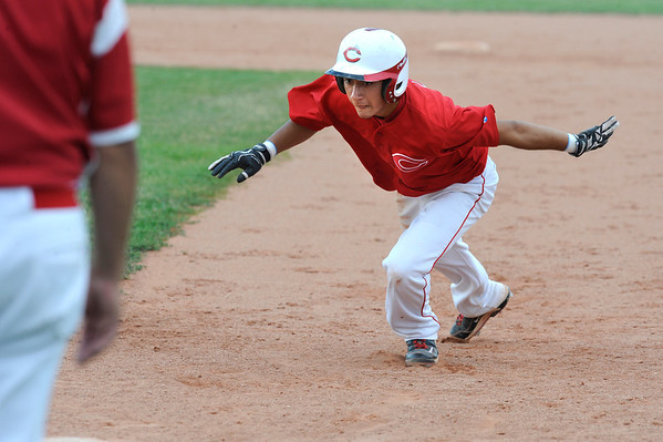 Centaurus High School's Tristan Archuleta dives safely back to first base on a pick off throw.<br /> Photo by Paul Aiken / The Camera / July 6, 2011