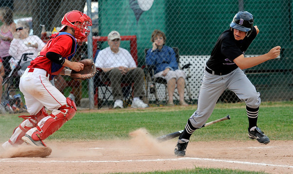Boulder Eagles' #2 Phillipe Guegan makes a dash for first after strike three hit the dirt as Centaurus High School's catcher Adam Devito prepares to throw him out at first base. <br /> Photo by Paul Aiken / The Camera / July 6, 2011