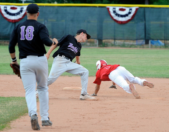 Centaurus High School's Tristan Archuleta dives around Boulder Eagles Shortstop Colby Smith as he made it safely to second base after being caught in a run down.<br /> Photo by Paul Aiken