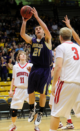 FVBBOYS<br /> Boulder's Ethan Baker jumps for a shot against Fairview.<br /> photo by Marty Caivano/Jan. 18, 2011