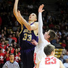 FVBBOYS<br /> Boulder's Andre Rieder puts up a shot while being guarded by Bryce Dolan of Fairview.<br /> photo by Marty Caivano/Jan. 18, 2011