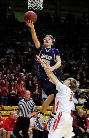 FVBBOYS<br /> Boulder's Riley Grabeau shoots over Caleb Pykkonen of Fairview.<br /> photo by Marty Caivano/Jan. 18, 2011