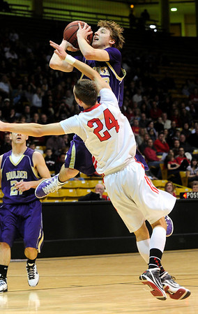 FVBBOYS<br /> Boulder's Riley Grabau shoots over Holden Killeen of Fairview.<br /> photo by Marty Caivano/Jan. 18, 2011