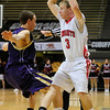 FVBBOYS<br /> Fairview's Chris Cartwright looks to pass while being guarded by Mark Krimstock of Boulder.<br /> photo by Marty Caivano/Jan. 18, 2011