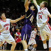 FVBBOYS<br /> Boulder's Loren Ban shoots over Jacob Lorentzen, left, and Holden Killeen of Boulder.<br /> photo by Marty Caivano/Jan. 18, 2011