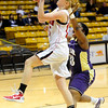 FVBGIRLS<br /> Fairview's Kristen Narum shoots past Ashley Kennedy of Boulder.<br /> photo by Marty Caivano/Jan. 18, 2011