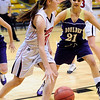 FVBGIRLS<br /> Fairview's Caitlin Higgins moves the ball past Kelly Rose Garza of Boulder. <br /> photo by Marty Caivano/Jan. 18, 2011