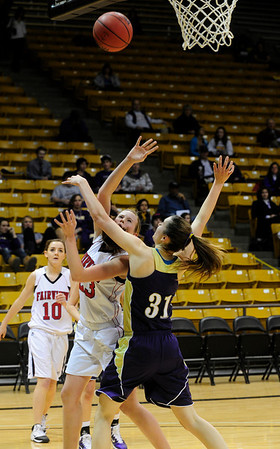 FVBGIRLS<br /> Fairview's Hannah Hyde shoots while being guarded by April Dawson of Boulder. <br /> photo by Marty Caivano/Jan. 18, 2011