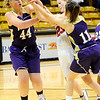 FVBGIRLS<br /> Fairview's Hannah Hyde loses control of the ball while under pressure from Ande Lampert, left, and Maddie Gates of Boulder.<br /> photo by Marty Caivano/Jan. 18, 2011
