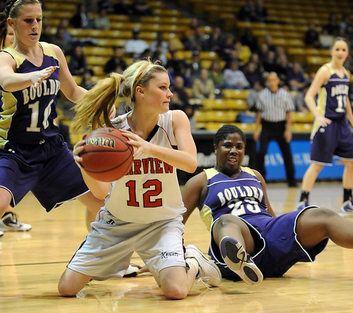 "Cassie Corrigan (12) of Fairview gets the ball away from Amy Coates, left, and  Ashley Kennedy (23) of Boulder.<br /> For more photos of the game, go to  <a href=""http://www.dailycamera.com"">http://www.dailycamera.com</a>.<br /> <br /> Cliff Grassmick / January 22, 2010"