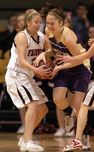 Casey Thayer, left, of Fairview, and Lizzie Hickey  of Boulder, fight for possession. For more photos of the game, go to www.dailycamera.com.  Cliff Grassmick / January 22, 2010