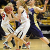 "Kristen Narum of Fairview gets past  Emilie Burns of Boulder.<br /> For more photos of the game, go to  <a href=""http://www.dailycamera.com"">http://www.dailycamera.com</a>.<br /> Cliff Grassmick / January 22, 2010"