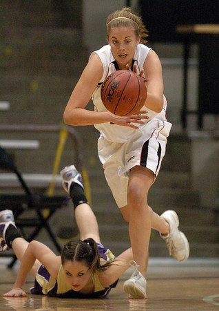 Casey Thayer of Fairview takes off with a steal from Madilin Gates of Boulder during the Friday game in Boulder.<br /> <br /> Cliff Grassmick / January 22, 2010