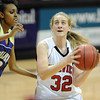 "Sierra bender of Fairview drives past Veronica Gebremarion of Boulder High.For more photos of the game, go to  <a href=""http://www.dailycamera.com"">http://www.dailycamera.com</a>.<br /> Cliff Grassmick / January 22, 2010"
