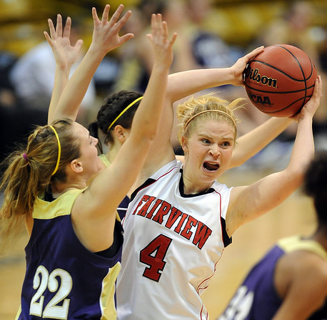 "Emily Narum of Fairview, keeps the ball from Leah Regan-Smith (22) of Boulder. For more photos of the game, go to  <a href=""http://www.dailycamera.com"">http://www.dailycamera.com</a>.<br /> Cliff Grassmick / January 22, 2010"